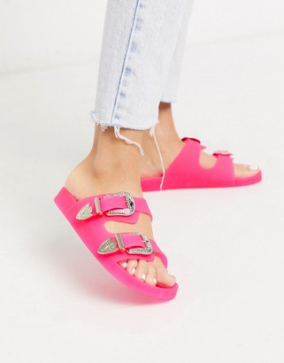 Asos DESIGN Falcon western jelly sandals in neon pink