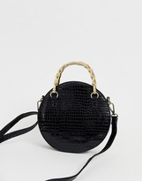 Asos Design DESIGN croc circle cross body bag with bamboo handle
