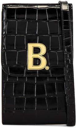 Balenciaga B Phone Holder in Black | FWRD