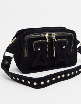 Nunoo Ellie corduroy cross-body bag in black with gold hardware
