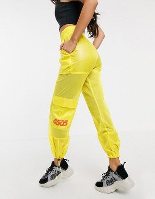 Asos 4505 oversized wide leg pants with pocket detail in neon