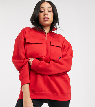 Daisy Street Plus half zip sweatshirt with utility pockets and flag embroidered badge