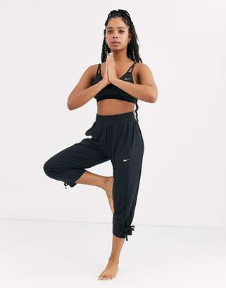 Nike Training Yoga loose fit pants with tie detail in black