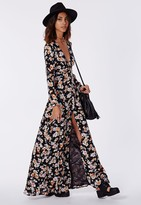 sienna miller  Who made Sienna Millers black leather handbag and floral print maxi dress?
