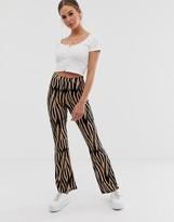 Asos Design DESIGN flare pants in stone tiger print