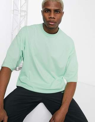 Asos Design DESIGN oversized t-shirt with half sleeve in pastel green acid wash
