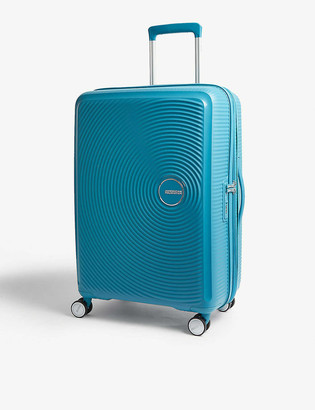 American Tourister Soundbox expandable four-wheel suitcase 67cm