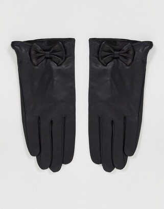 Barneys New York real leather gloves with bow detail in black