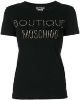 Moschino logo studded T-shirt - women - Cotton - 40