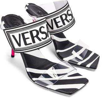 Versace Logo Clear Heel Sandals in Black & Fuchsia | FWRD