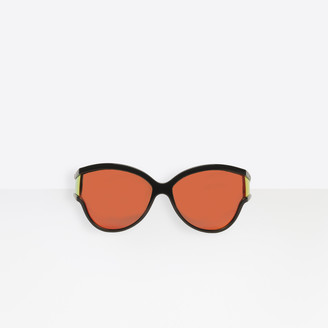 Balenciaga Sunglasses in black injected with orange lenses