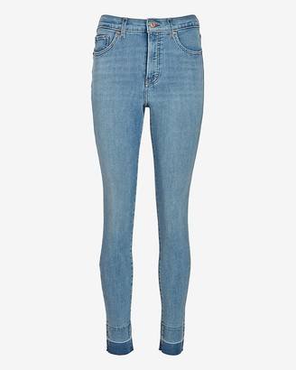 Express High Waisted 4-Way Hyper Stretch Raw Skinny Jeans