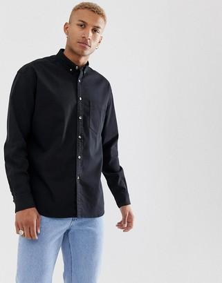 Asos DESIGN regular fit denim shirt in black with mock horn buttons