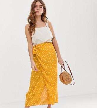 Asos DESIGN Petite wrap maxi skirt with tie front in yellow polka dot