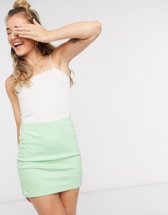 Monki Daria jersey mini skirt with splits in pastel green