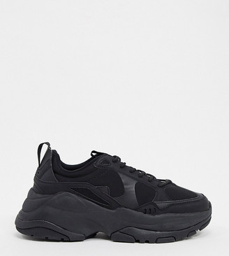 ASOS DESIGN Wide Fit trainers in black with chunky sole