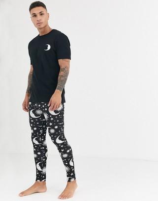 ASOS DESIGN lounge pyjama megging and t-shirt set with celestrial print in black