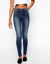 Monki Mocki Mid Rise Skinny Jeans In Mid Wash