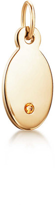 Tiffany & Co. Charms oval tag in 18k gold with a spessartite, mini