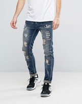 Reason Extreme Distressed Slim Jeans With Paint Splat And Skull Stencil