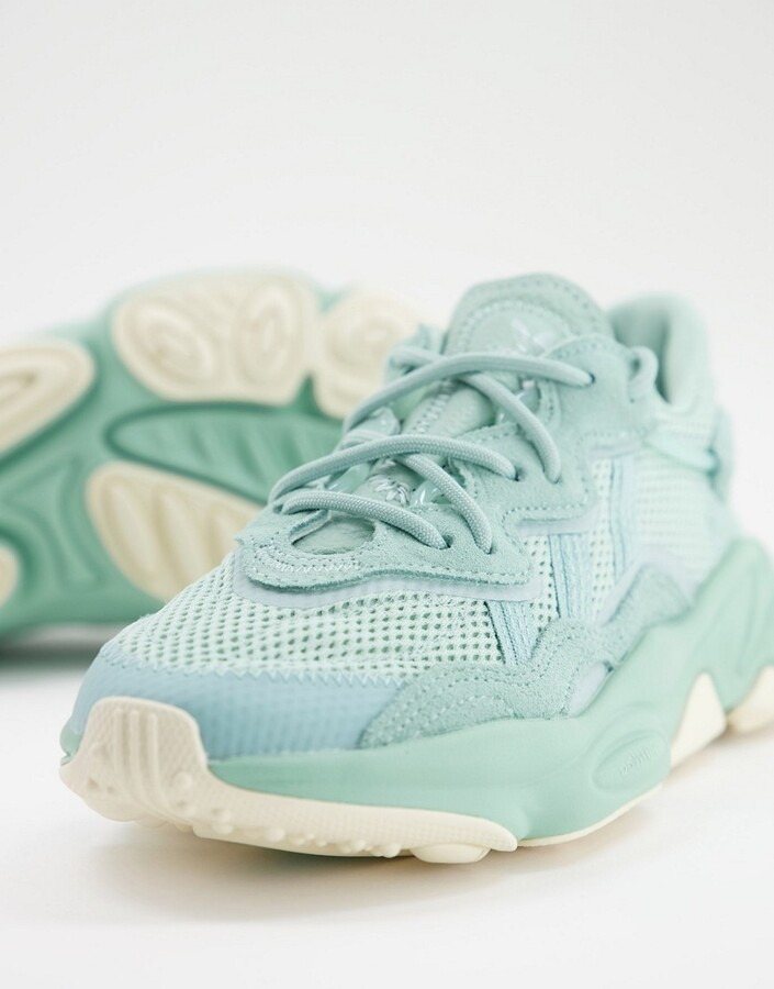 Thumbnail for your product : adidas Ozweego trainers in pale green