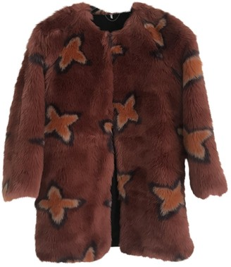 Free People Pink Faux fur Coats