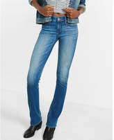 Express medium wash mid rise barely boot jeans