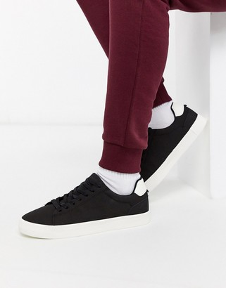 Bershka sneakers in black with contrast white sole