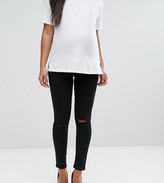 Asos DESIGN Maternity Ridley high waisted skinny jeans in clean black with ripped knees with over the bump waistband