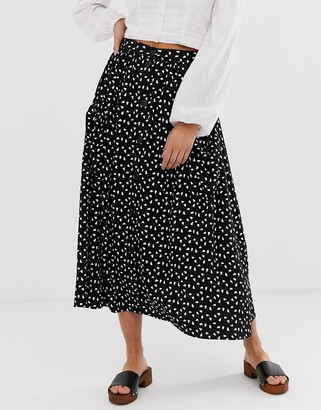 ASOS DESIGN button front midi skirt with pockets in mono print