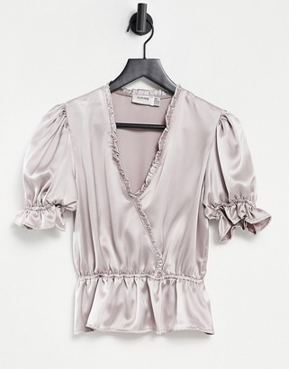 Flounce London Flounce wrap front blouse with puff sleeves and frill detailing in metallic silver