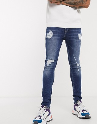 ASOS DESIGN super skinny jeans in vintage dark wash blue with heavy rips