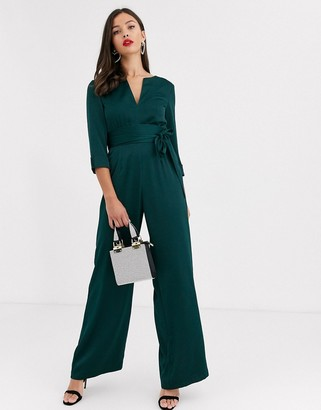 Paper Dolls satin plunge jumpsuit with tie waist in bottle green