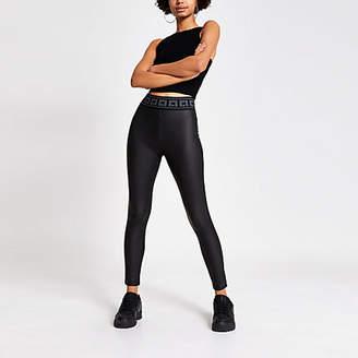 River Island Black coated RI tape waist leggings