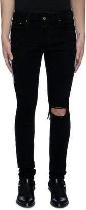 Amiri Tie dye outseam ripped knee dark wash jeans