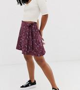 Asos DESIGN Petite wrap mini skirt with tie waist in floral print