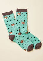 These seafoam socks aptly combine two of the things you love most - sweet fox faces and love itself! Boasting brown trim and a black heart pattern, these cute crews complete you.