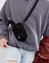 Asos Flight Bag In Washed Black With Pocket Detail