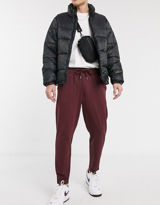 ASOS DESIGN organic tapered joggers with pleats in burgundy