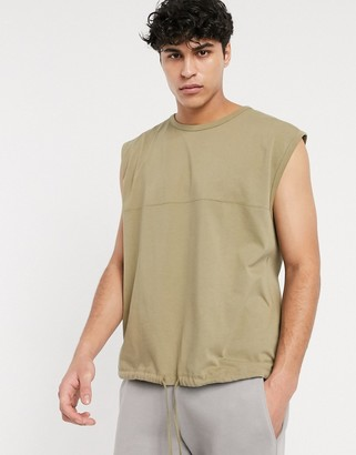 ASOS DESIGN heavyweight oversized sleeveless t-shirt with seam detail and tie hem in washed khaki