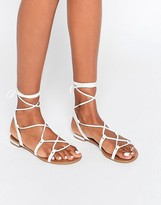 Call it SPRING Cargalla Flat Lace Up Crossover Sandal