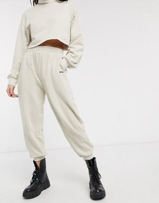 Bershka No Item slogan oversized jogger in beige