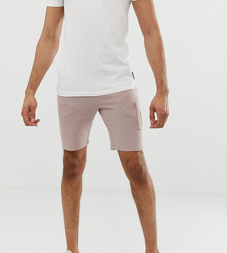 ASOS DESIGN Tall jersey skinny shorts with MA1 pocket in pink