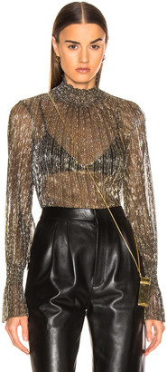 L'Agence Paola Long Sleeve Turtle Neck Blouse in Gold Metallic | FWRD