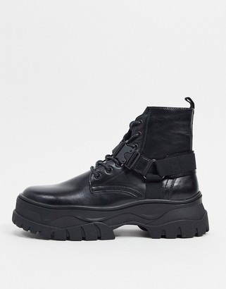 ASOS DESIGN lace up boots in black faux leather with strap detail on chunky sole