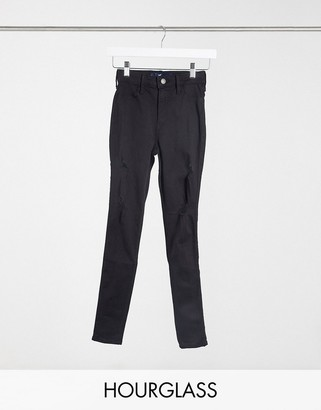 Hollister hourglass skinny jeans with rips in black