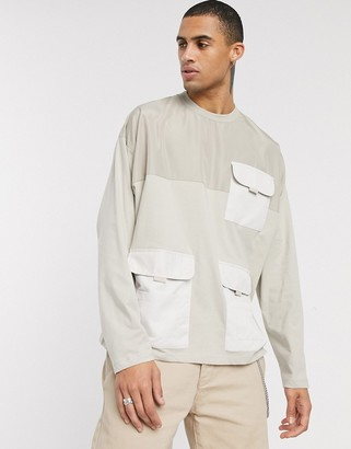 ASOS DESIGN oversized long sleeve t-shirt with woven utility pockets in beige