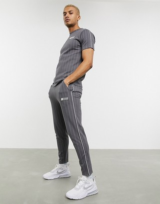 The Couture Club pin stripe smart tapered joggers in grey