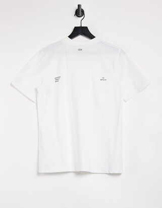 Lacoste t-shirt with mini text printed on back in white