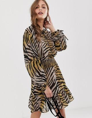 ASOS DESIGN mini dress with elasticated waist in colored zebra print